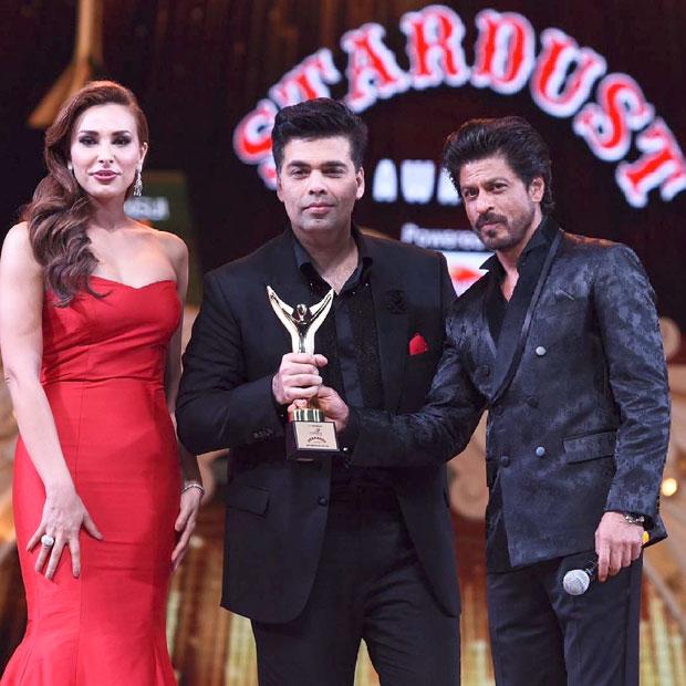 Iulia Vantur and Shah Rukh Khan together present the award to Karan Johar