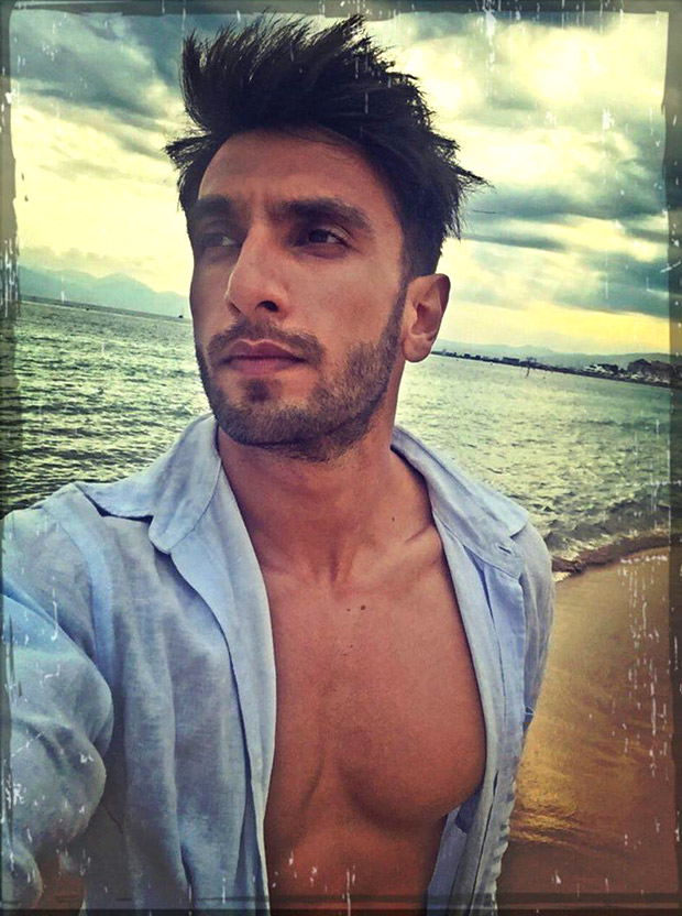 A bare chested Ranveer Singh who is miles away