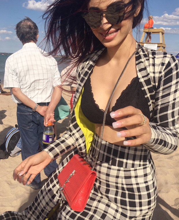 WOW! Mouni Roy looks hot chilling at the beach in this black bikini top (5)
