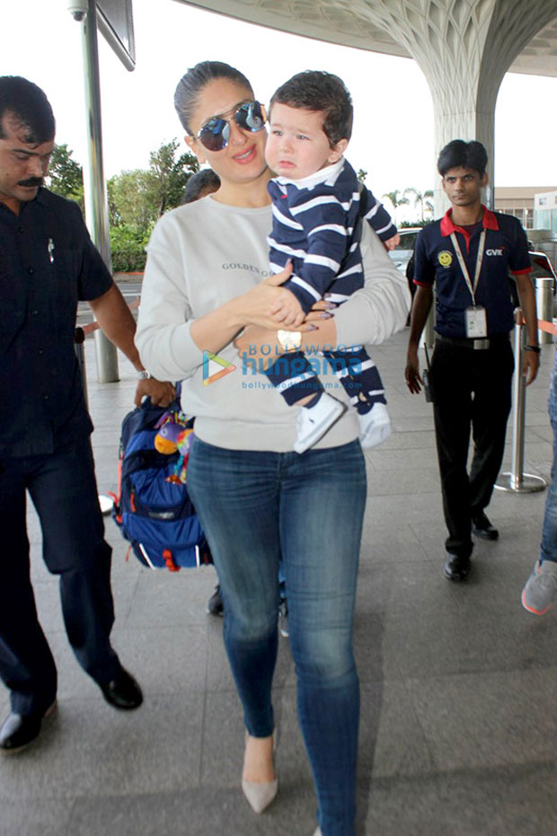 Check-out-Kareena-Kapoor-Khan-tries-to-console-a-crying-baby-Taimur-while-leaving-for-Delhi-for-Veere-Di-Wedding