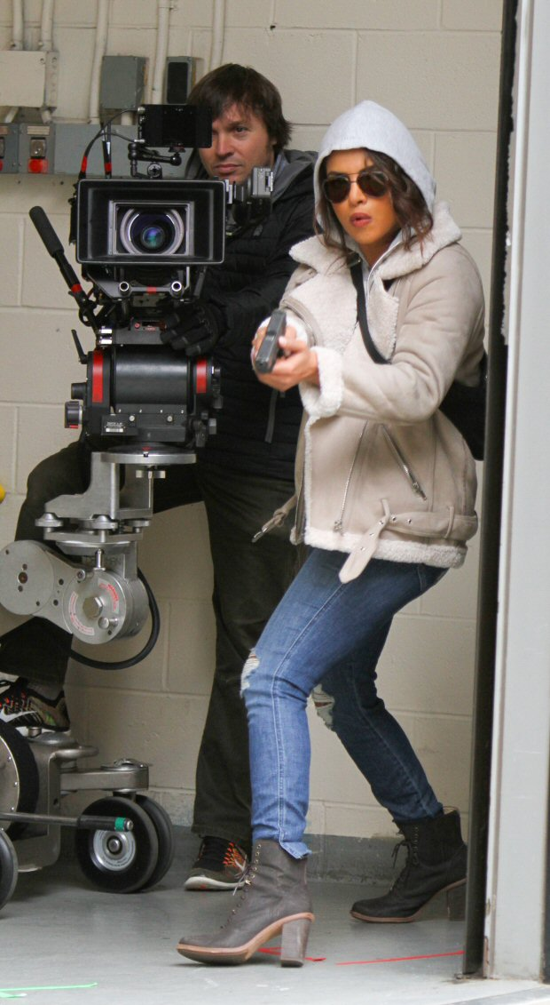 Check out Priyanka Chopra points a gun at someone while shooting an action scene for Quantico on the streets of NYC