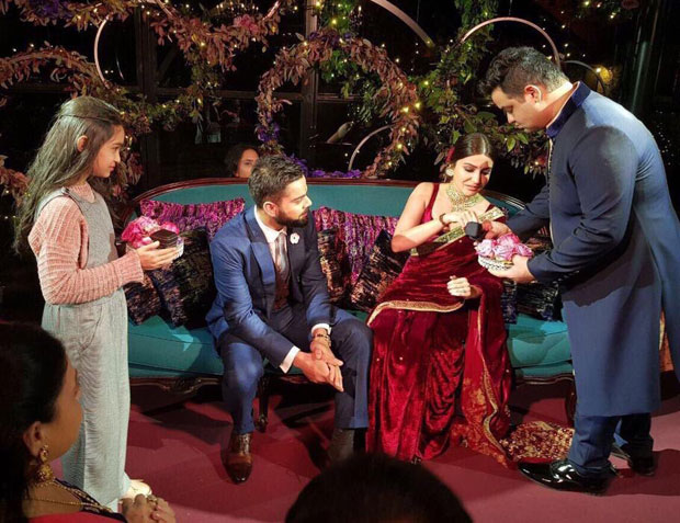 Virat Kohli gives a sweet kiss to Anushka Sharma after their engagement ceremony-03