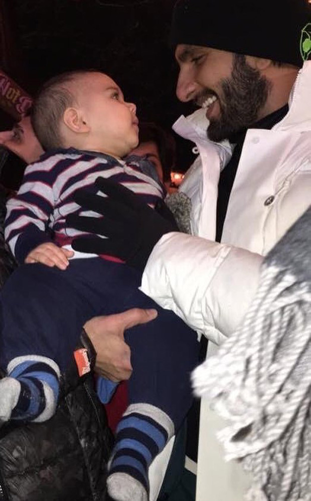 WATCH Ranveer Singh cuddles a cute little baby in London and it's absolutely adorable