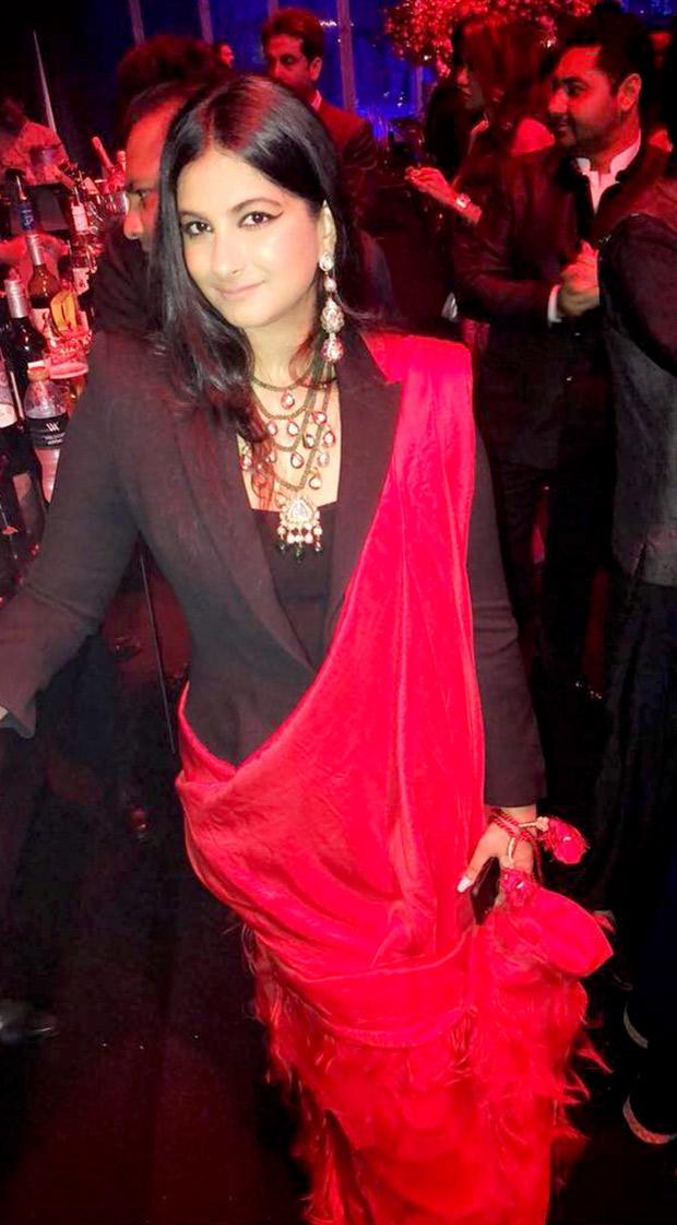 Rhea Kapoor in an Alexander McQueen suit and Anamika Khanna saree at the Mohit Marwah and Antara Motiwala wedding