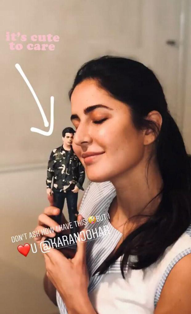 Katrina Kaif poses with a miniature doll of Karan Johar