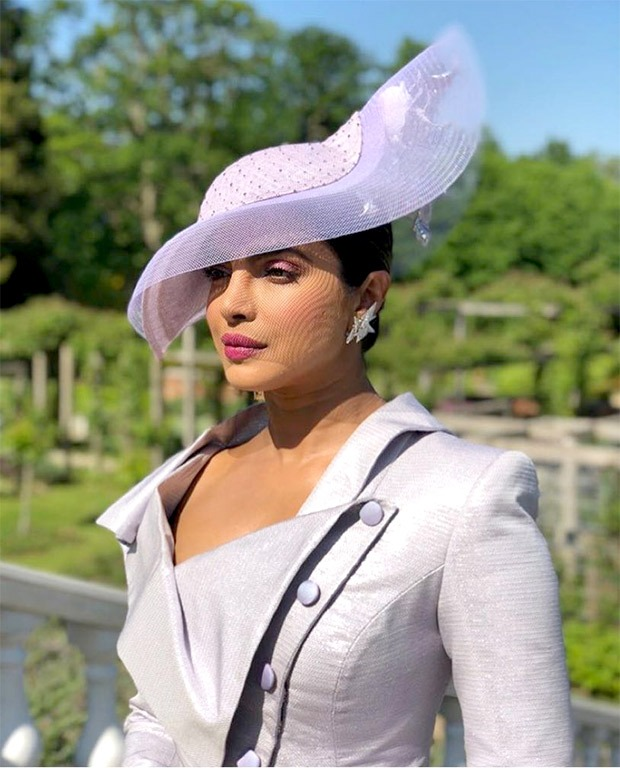 Can't keep calm! Priyanka Chopra is at the royal wedding and she looks drop dead amazing in Vivienne Westwood!