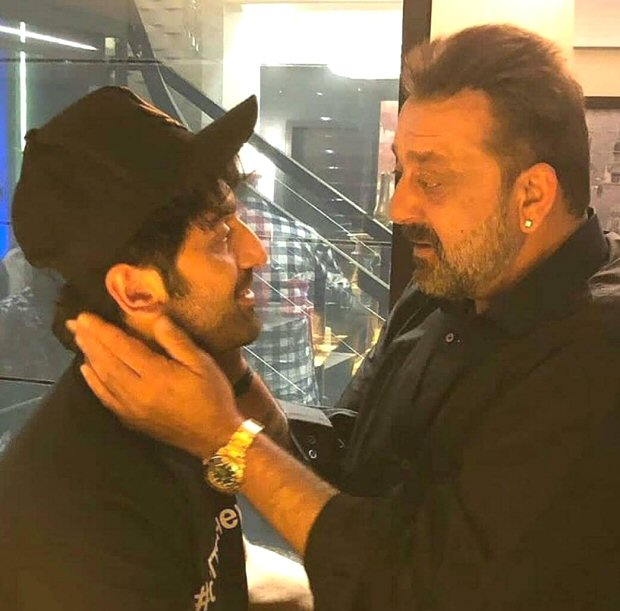 Ranbir Kapoor and Sanjay Dutt caught in a candid moment as they catch up ahead of Sanju release