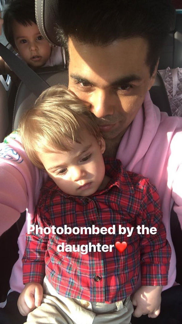 This image of Roohi photo bombing Karan Johar and Yash is simply the cutest