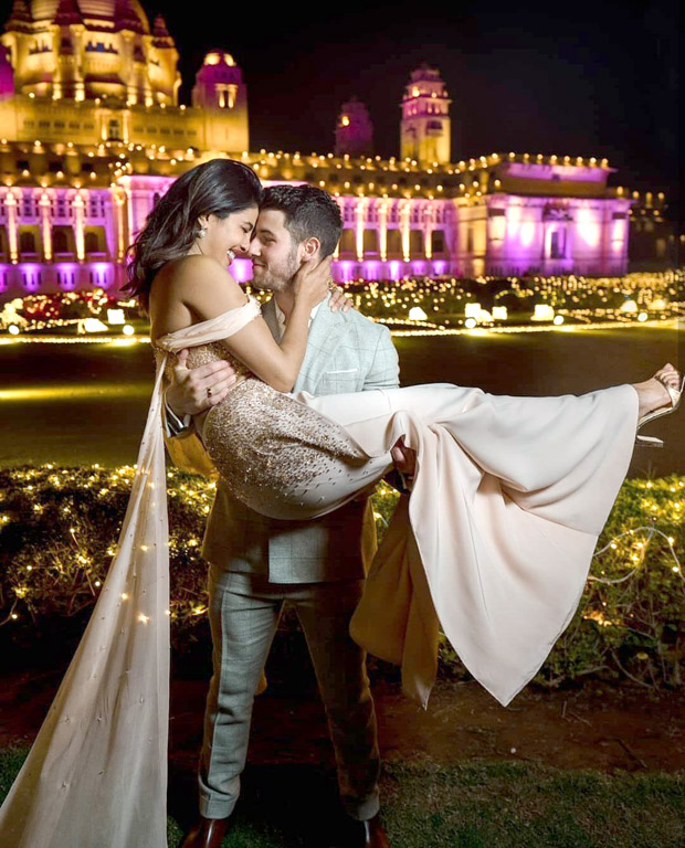 Priyanka Chopra is swept off her feet by hubby Nick Jonas in this lovely dovey wedding photo