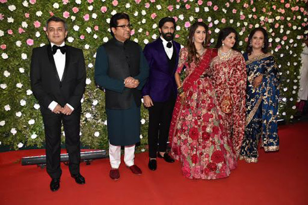 Last night, Raj Thackerey's son Amit Thackerey tied the knot with fashion designer Mitali Borude. The couple got engaged in December, last year in a small family-only function. With the wedding reception held in Mumbai yesterday, the Thackereys decided to invite a handful of Bollywood actors along with some prominent politicians. Actors like Shah Rukh Khan, Amitabh Bachchan, Salman Khan, and Madhuri Dixit attended the event to congratulate the newlyweds. Dressed in a three-piece suit, Shah Rukh looked dapper as ever. While Salman went for more of a look with leather jacket and a t-shirt paired with denims, Big B pulled off an indo-western look clearly giving most of the young actors a run for their money. Check out inside pictures from the reception. It surely was a glamorous night. Here's congratulating the newly wed couple a happy married life!