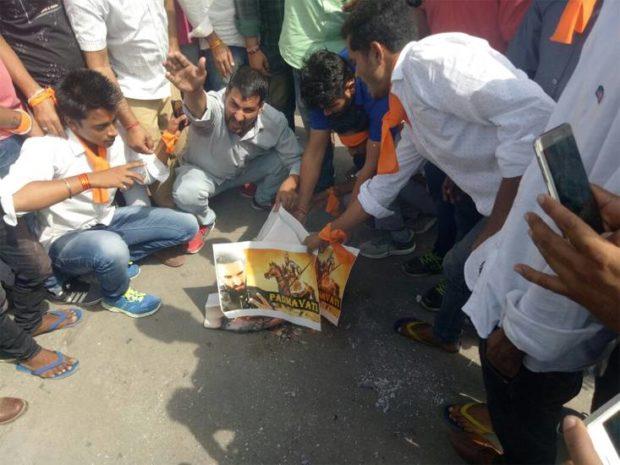 Karni Sena members burn posters