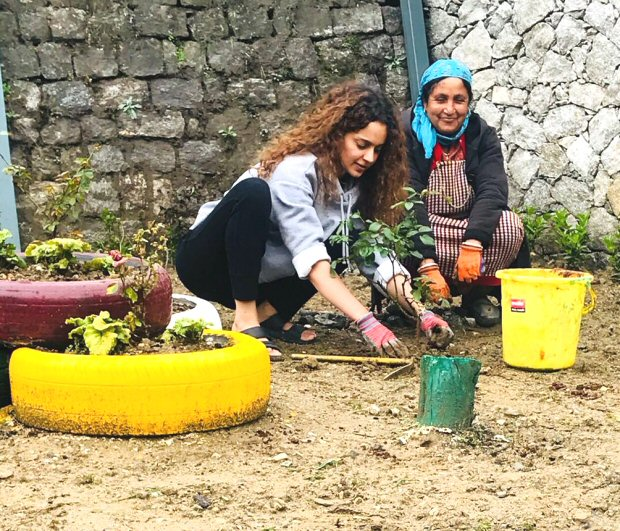 """Just recently we had reported that Kangana Ranaut had bought herself a new bungalow in Manali. In fact, we had also shared an image of a pooja being done that featured Kangana and her family. Well today, Kangana Ranaut turns a year older and to mark this special occasion the actress decided to do something that not only benefits the environment but will also serve as memory for years to come. Marking this special day Kangana Ranaut decided on planting 31 saplings in the yard of her new bungalow in Manali. Taking to the micro blogging website, Kangana's sister Rangoli shared an image of the actress getting her hands dirty in the mud while planting the saplings. Posting the image Rangoli added, """"On her b'day our little Queen gifts herself a greener planet ...May you live long and live a beautiful life .. #HappyBirthdayKanganaRanaut"""". While we must admit that this sure is a way to pay it forward on your special day, back on the work front Kangana Ranaut who was last seen in Simran has her hands full. She is currently shooting for the ambitious film Manikarinka – The Queen of Jhansi. And soon, she will commence work on her next venture Mental Hai Kya with Rajkummar Rao. Besides these two, the actress is also supposed to do a film with Shekhar Kapur in which she plays the role of an 85-year-old woman."""