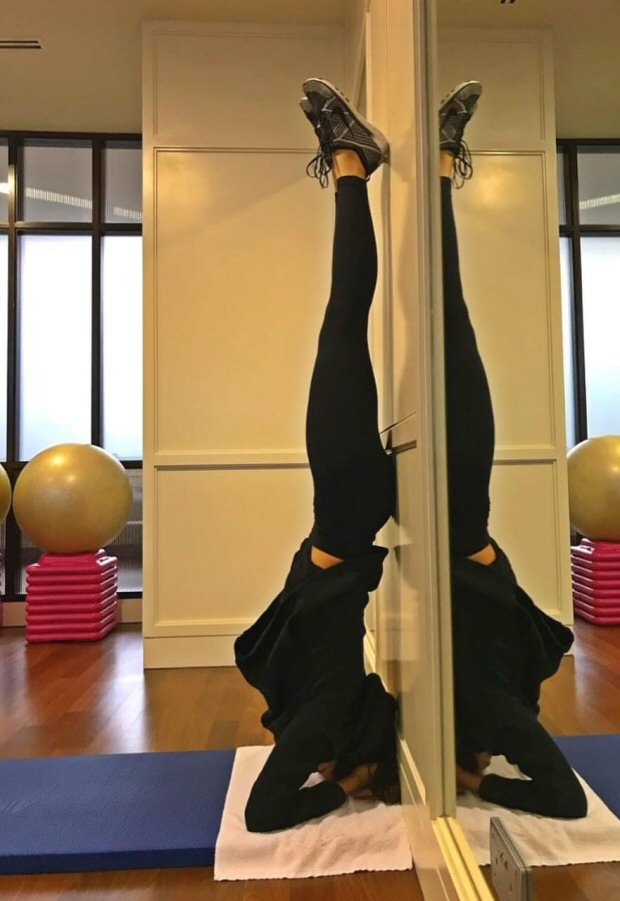 Deepika Padukone aces the headstand with such an ease giving major workout goals