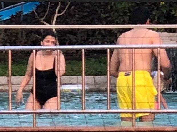 Aishwarya Rai Bachchan flaunts a BLACK SWIMSUIT as she enjoys pool time with Abhishek Bachchan and Aaradhya