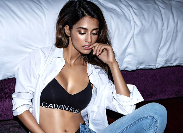 Hot! Disha Patani Goes Classy With An Open White Shirt And Snug Pair Of Denims