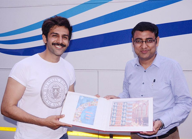 Kartik Aaryan is all smiles as he receives a customised stamp collection from Lucknow