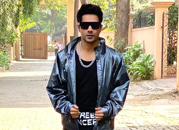 Varun Dhawan dons a metallic track suit along with retro shades just when he thought he couldn't look more dapper!