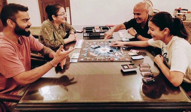 """""""Make the most of these moments"""" - Anushka Sharma shares picture of Virat Kohli and her parents playing monopoly"""