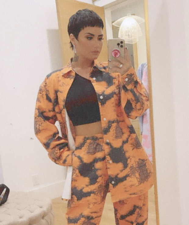 Demi Lovator sets summer vibe in her printed orange co-ords with Balenciaga boots worth Rs. 82,000