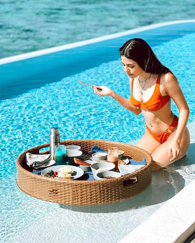Alaya F enjoys floating breakfast in the pool in orange bikini in Maldives